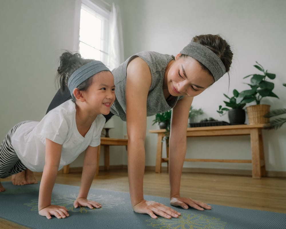 Resident doing yoga with her daughter at Greenfield Village in Rocky Hill, Connecticut