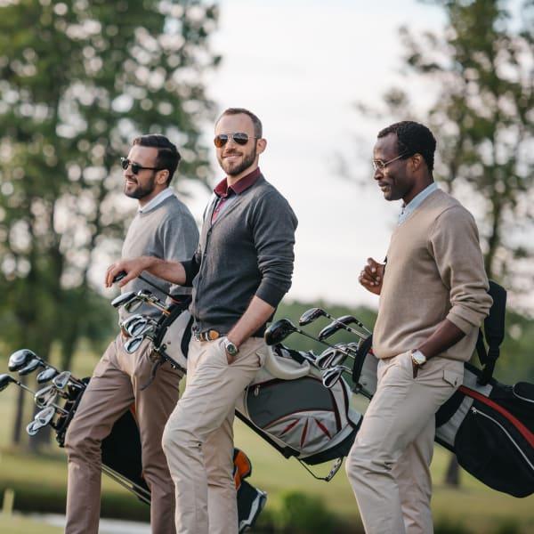 Coworkers golfing together near Ocio Plaza Del Rio in Peoria, Arizona