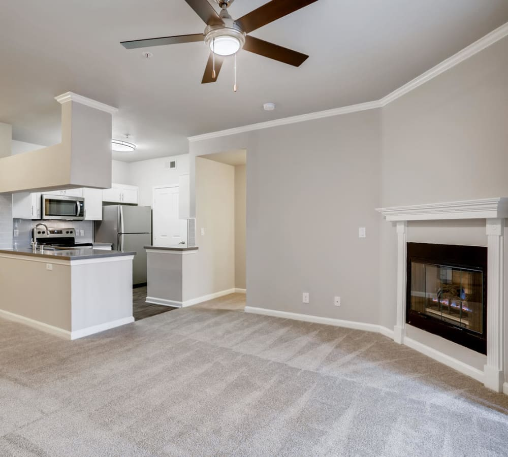 Spacious living room with a fireplace at Alize at Aliso Viejo Apartment Homes in Aliso Viejo, California