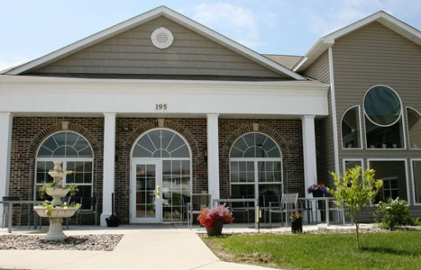 Exterior view of main entrance at Traditions of Owatonna in Owatonna, Minnesota