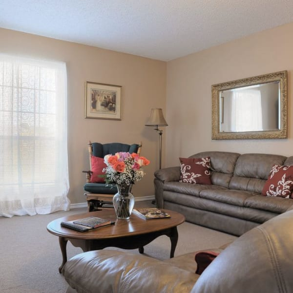 Senior apartment living room at Quail Park of Granbury in Granbury, Texas