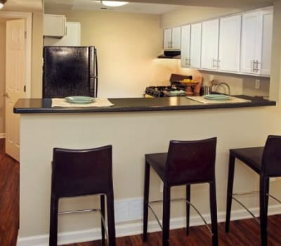 Dining area and kitchen at Nineteen North Apartments in Pittsburgh, Pennsylvania