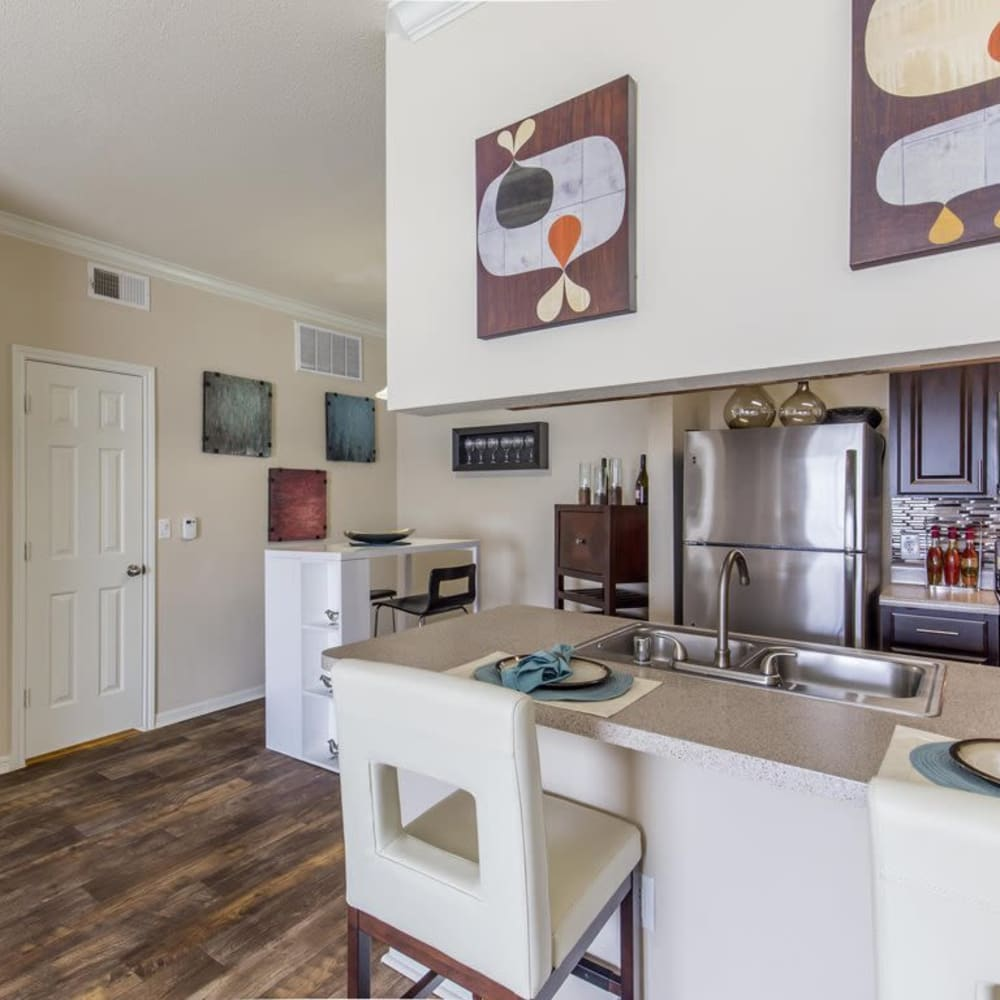 Kitchen with a spacious breakfast bar at Ranch at Hudson Xing in McKinney, Texas
