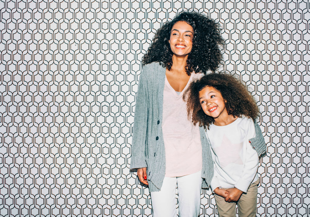 Resident mother and daughter posing for a photo at Sofi Dublin in Dublin, California