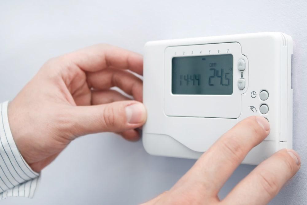 Adjusting a thermostat at Extra Attic Mini Storage - Glen Allen in Glen Allen, Virginia