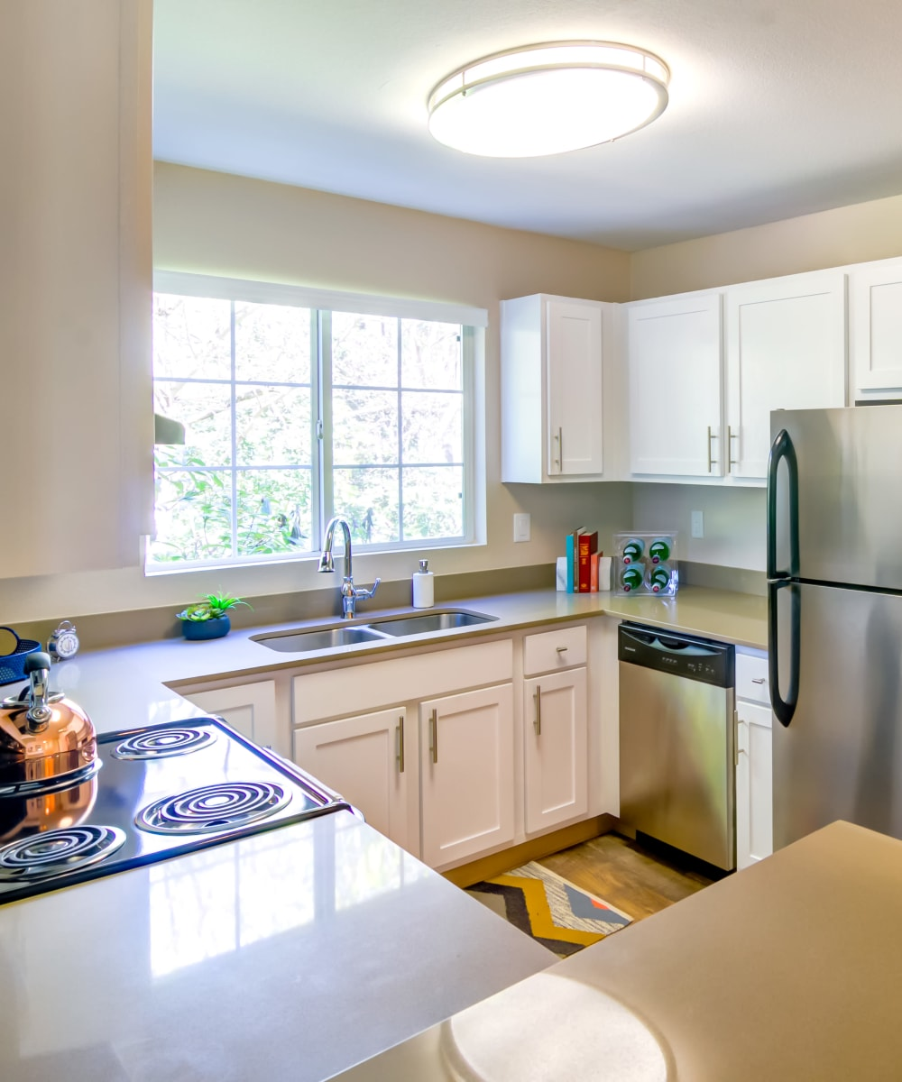 Model home's kitchen with quartz countertops and ample natural light at Sofi at Murrayhill in Beaverton, Oregon