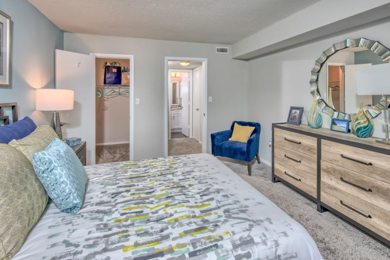 Well lit model bedroom and spacious closet for storage at The Madison in Charlotte, North Carolina