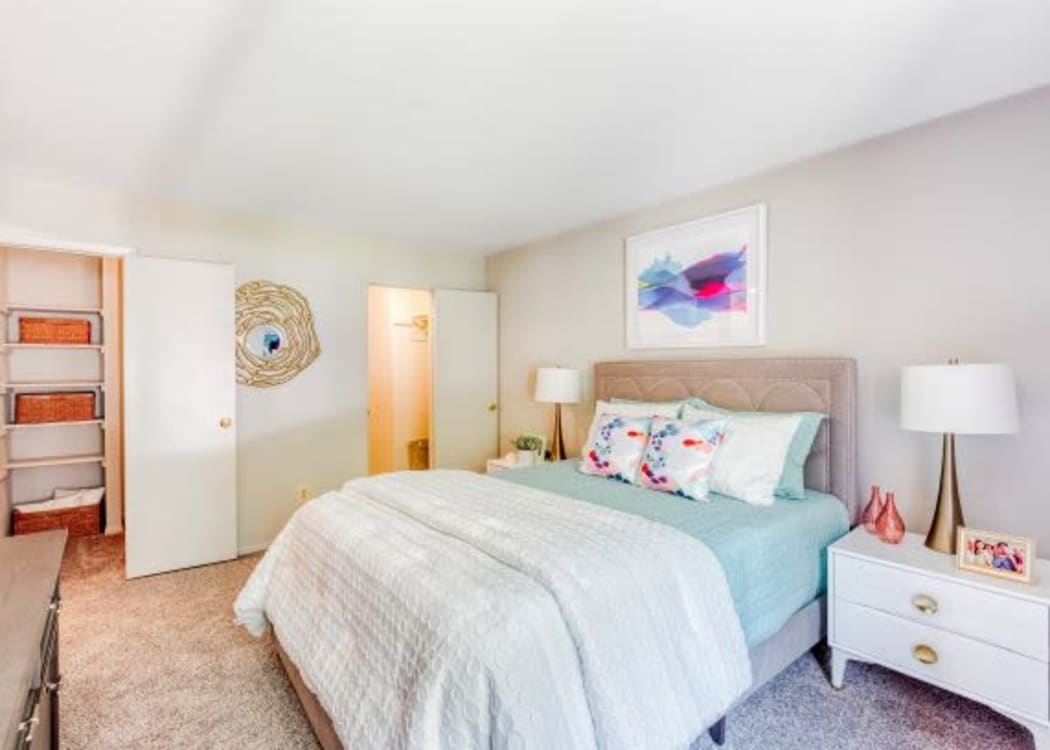 Large bedroom in a model home at The Timbers at Long Reach Apartments in Columbia, Maryland