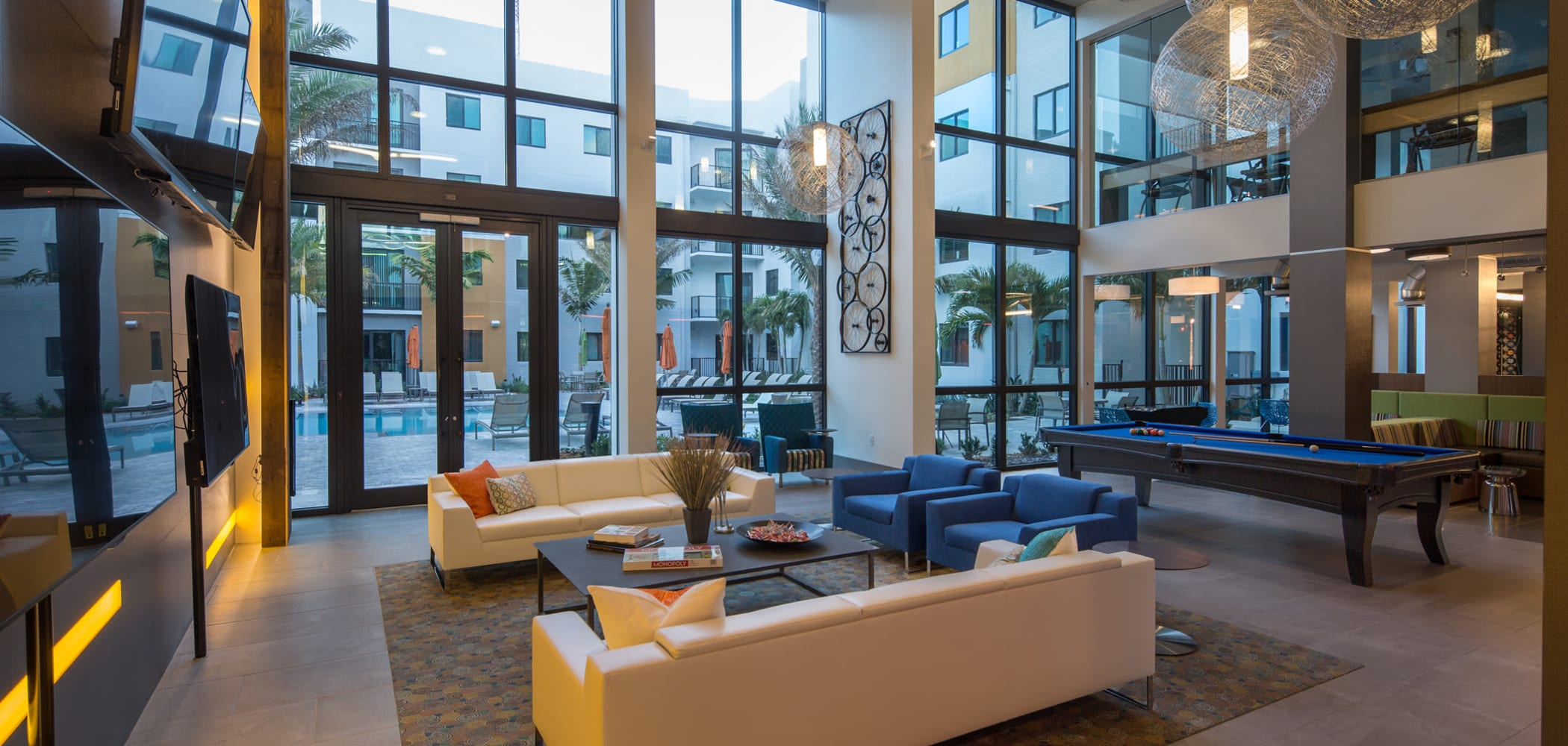 Tons of natural light with floor to ceiling windows in the game and lounge area at University Park in Boca Raton, Florida