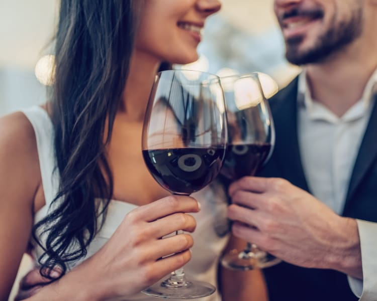 Couple raising their glasses in their new home at Sofi Waterford Park in San Jose, California