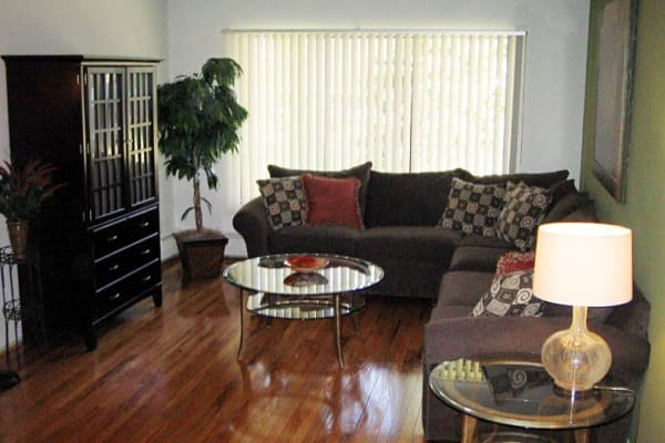 Spacious living room at Ann Arbor Woods Apartments in Ann Arbor, Michigan