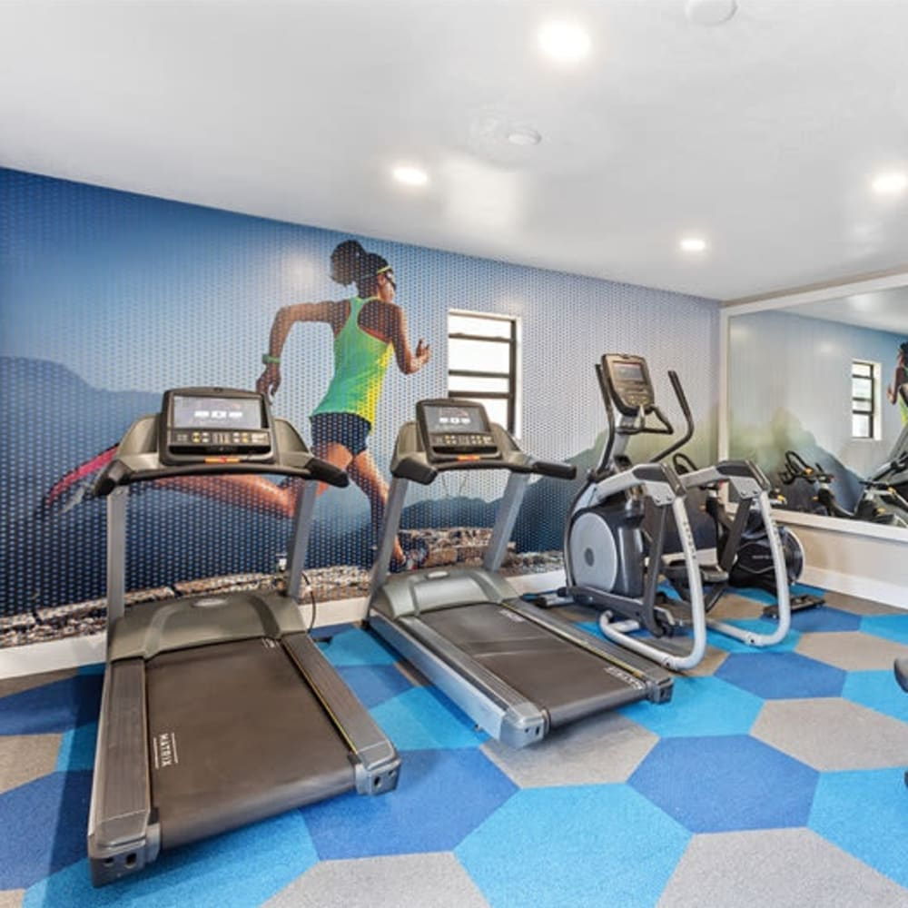 A fitness center with aerobic machines at 1408 Casitas at Palm Valley in Avondale, Arizona