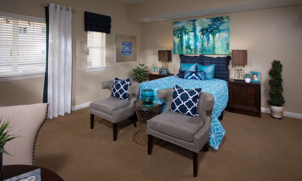 Enjoy a bedroom at Estancia Del Sol senior living community