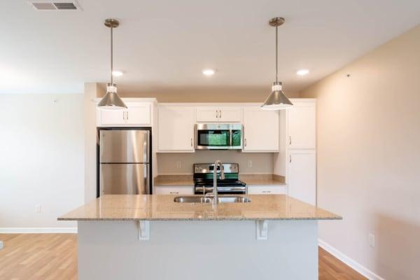 Bright kitchen at Bennington Hills Apartments in West Henrietta, New York