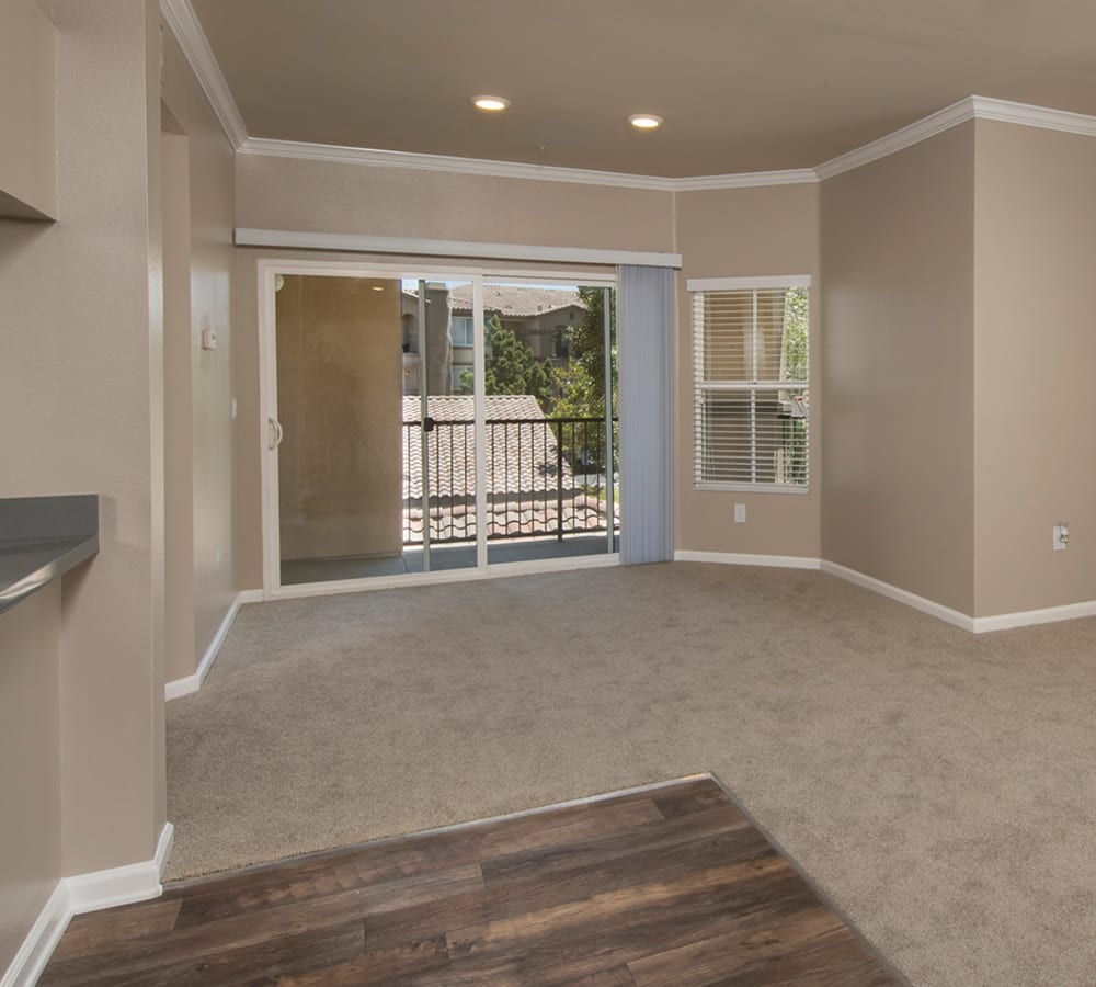 Large living room with back-patio access at Esplanade Apartment Homes in Riverside, California