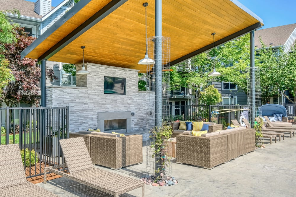 Covered lounge seating by the pool at Centro Apartment Homes in Hillsboro, Oregon