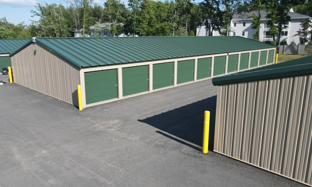 A row of outdoor units with green doors at 603 Storage - East Milford in Milford, New Hampshire