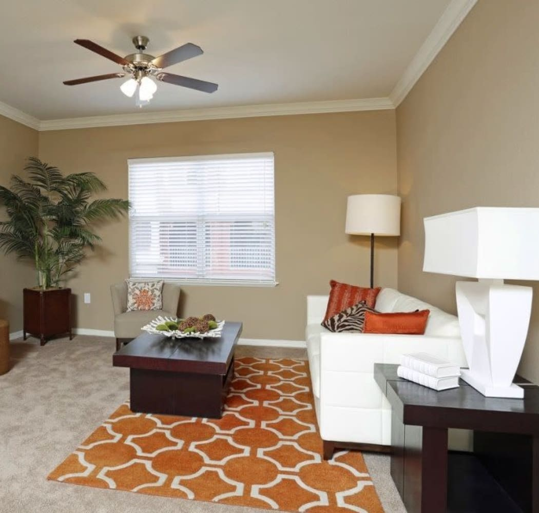 Spacious living room with a ceiling fan and window at Amara at MetroWest in Orlando, Florida