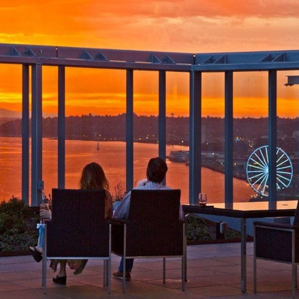 Couple enjoying the views from the rooftop lounge at The Wave at Stadium Place in Seattle, Washington