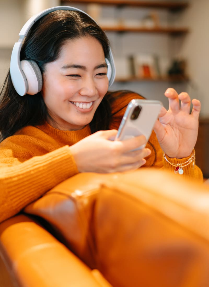 Resident with headphones listening to music at Fort Worth, Texas from Marquis at Bellaire Ranch