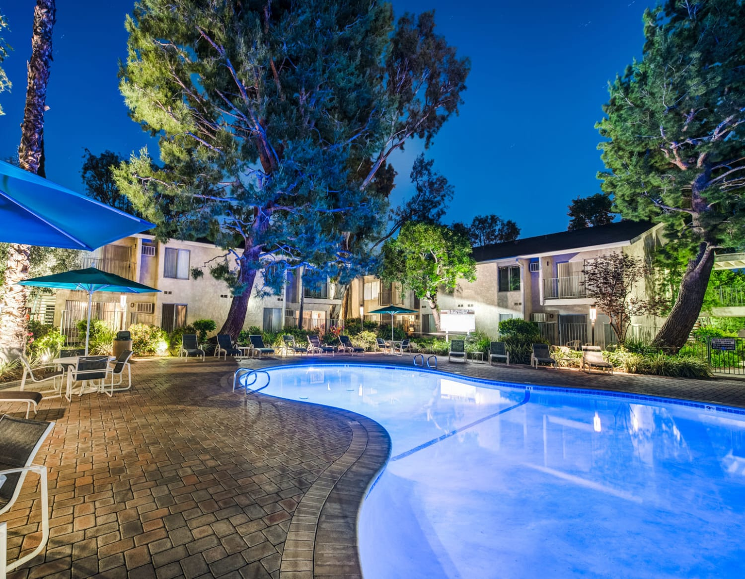 Swimming pool area lit up at night at Village Pointe in Northridge, California