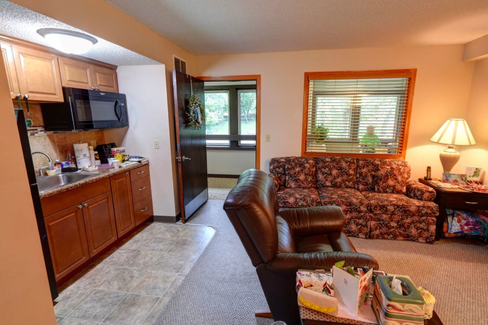 Comfortable apartment with kitchenette at Garnett Place in Cedar Rapids, Iowa.