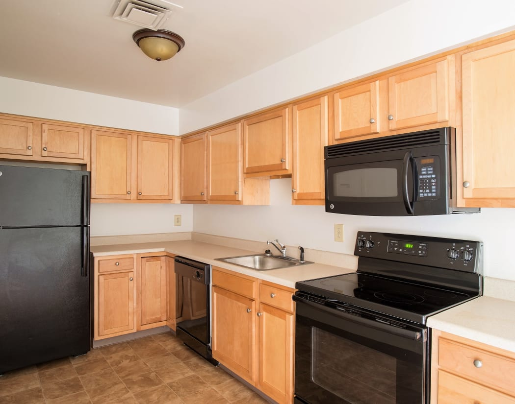 Fully equipped kitchen at Indian Brook Apartments in Glenville
