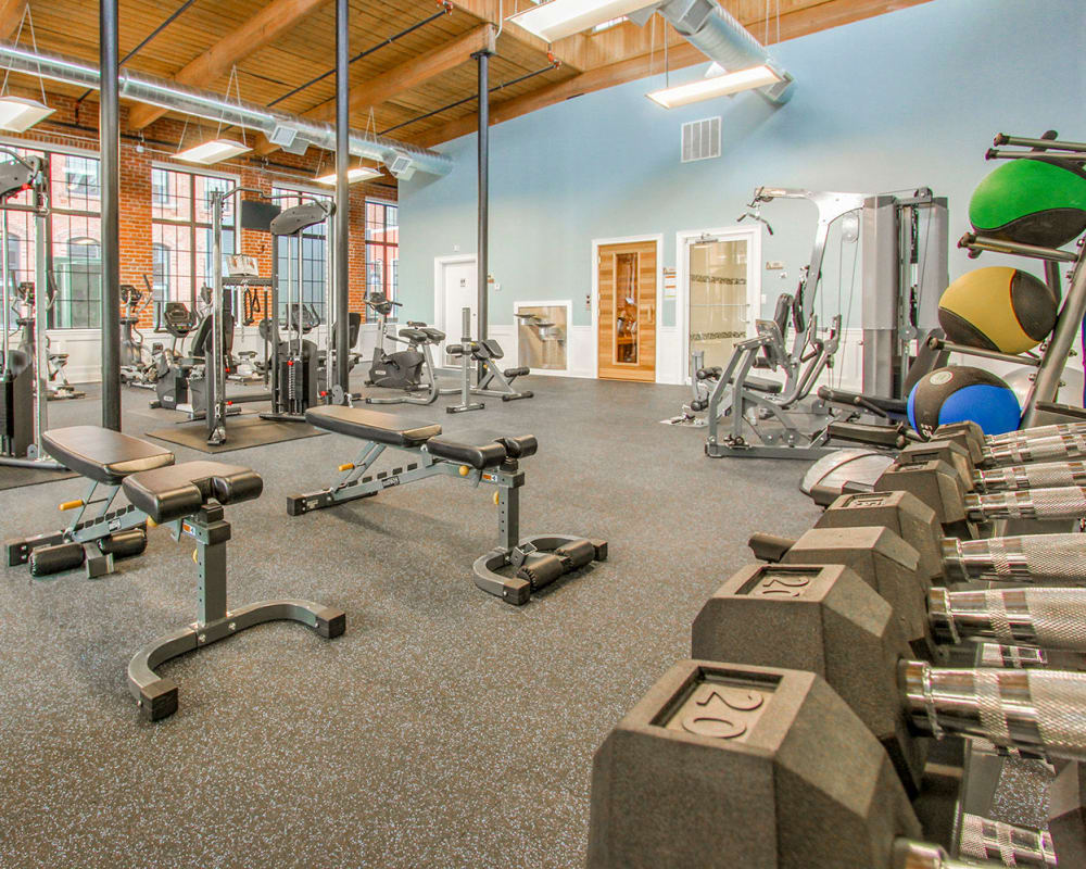 Fully equipped fitness center at The Lofts at Ponemah Mills in Taftville, Connecticut