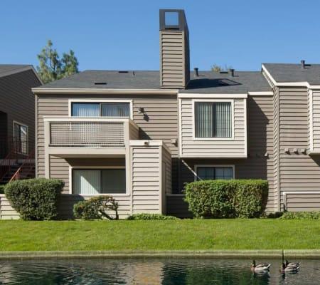 Apartment surrounded by a lush landscape at Hidden Lake Condominium Rentals in Sacramento, California