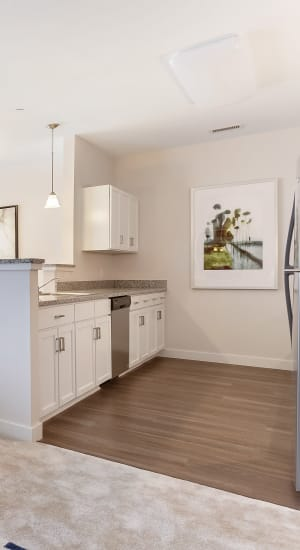 Kitchen with wood style flooring at Gateway Commons in East Lyme, Connecticut