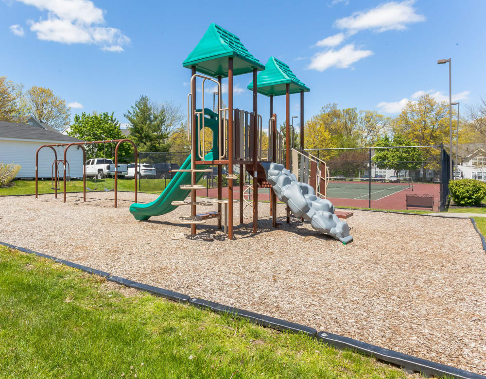 Onsite playground and tennis courts at Vista Point Apartments in Wappingers Falls, New York
