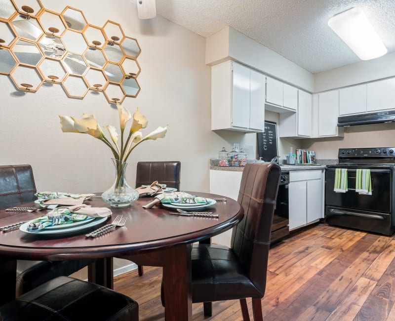 Kitchen with a dining area and dishwasher at 8500 Harwood Apartment Homes in North Richland Hills, Texas