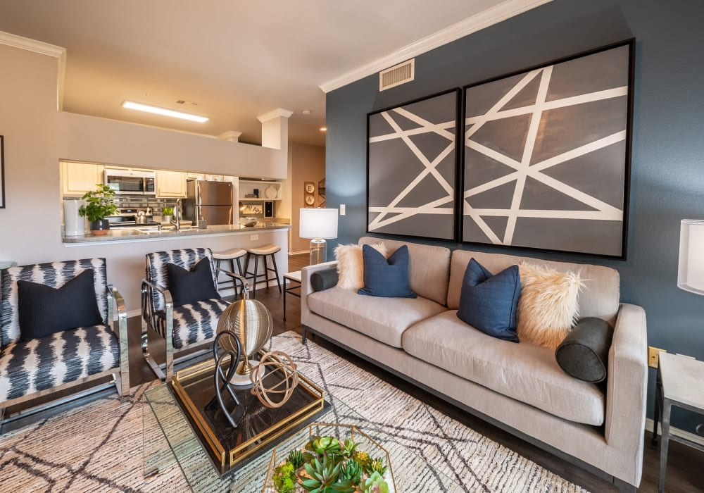 Well-decorated open-concept living space in a model home at 23Hundred @ Ridgeview in Plano, Texas