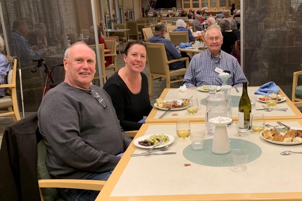 Residents and family enjoying a meal at Merrill Gardens at Auburn in Auburn, Washington.