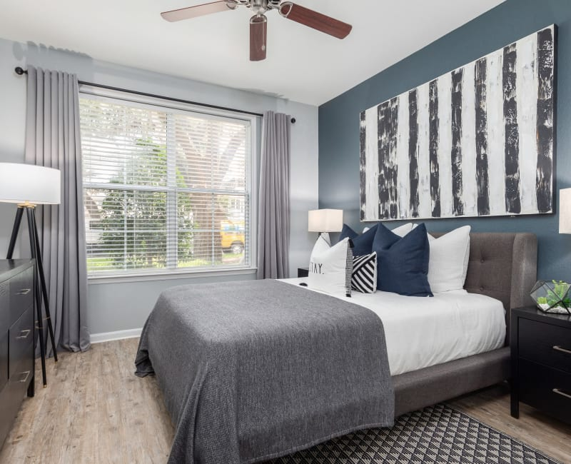 Well-decorated bedroom in model home at Luxe at 1820 in Tampa, Florida