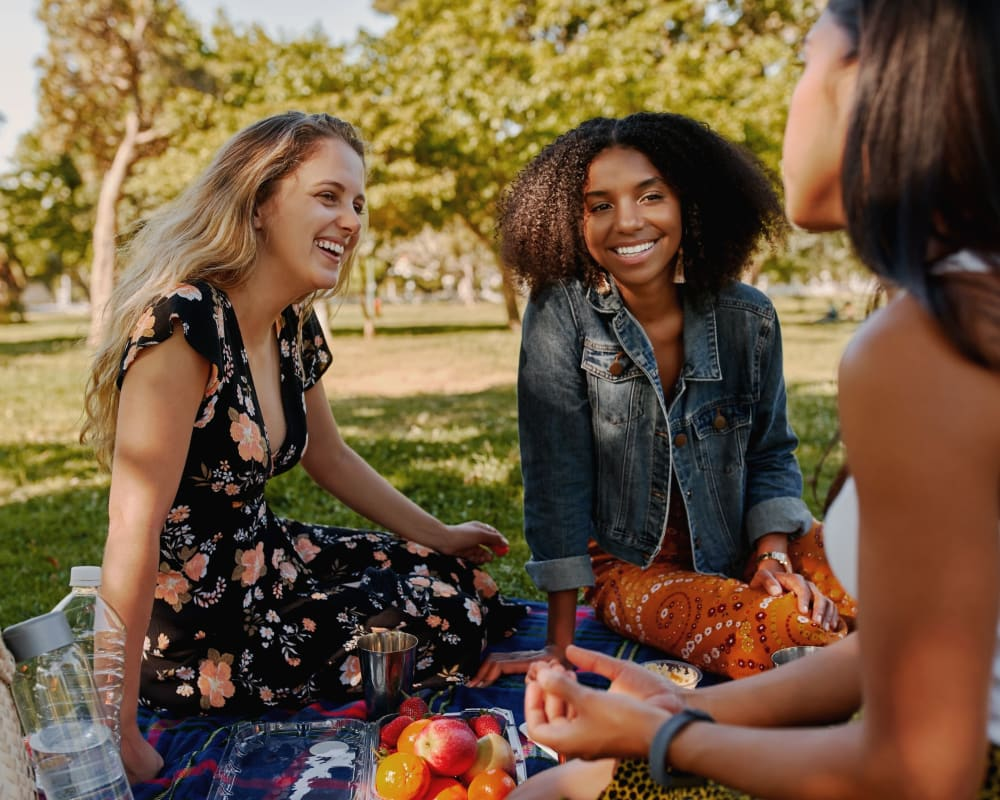 Women out enjoying a picnic near Southern Cove Apartments in Temple Terrace, Florida