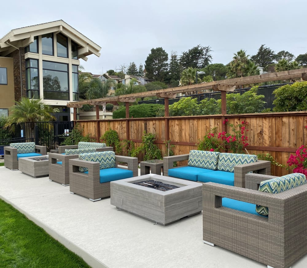Outdoor lounge area near the pool at Harbor Point Apartments in Mill Valley, California