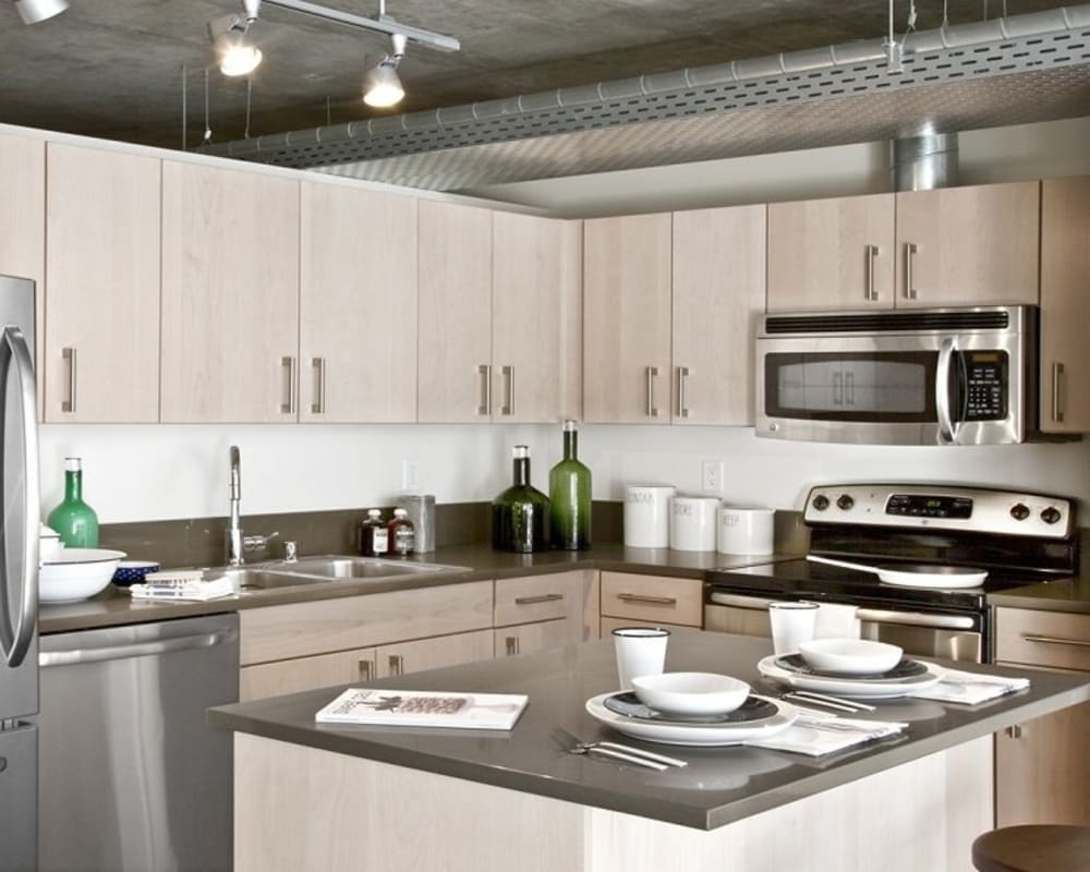 Kitchen with stainless steel appliances at The Nolo at Stadium Place in Seattle, Washington