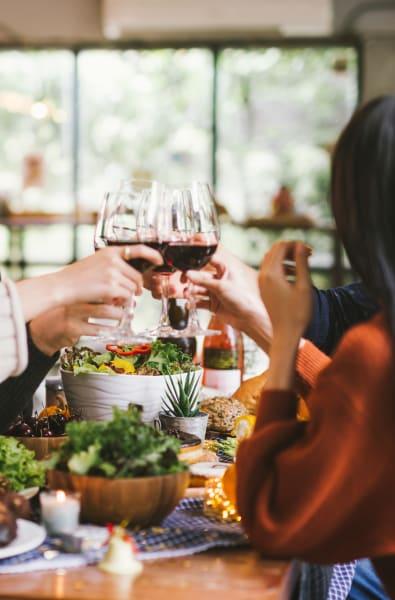 Friend enjoying wine together in Danvers, Massachusetts near Bradlee Danvers
