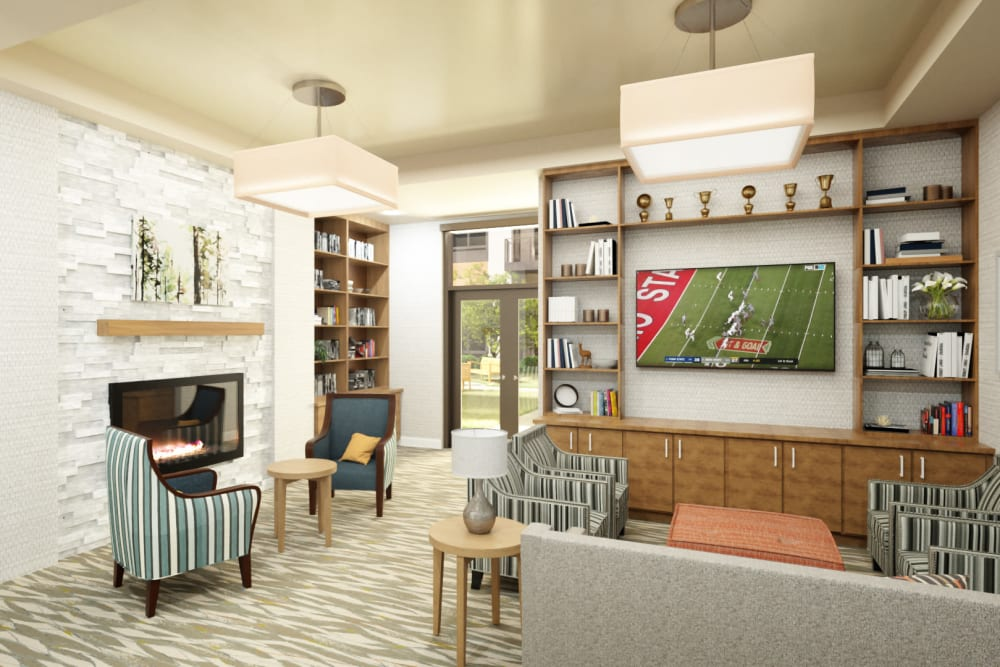Resident community room with a TV and fireplace at Anthology of Mayfield Heights - OPENING 2020 in Mayfield Heights, Ohio