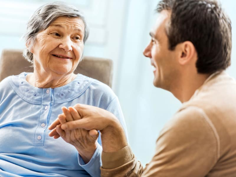 A resident talking to a CNA at Highland Crest Senior Living in Kirksville, Missouri