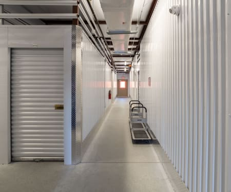 Bright and clean interior storage unit hallway at StorQuest Express - Self Service Storage in Deltona