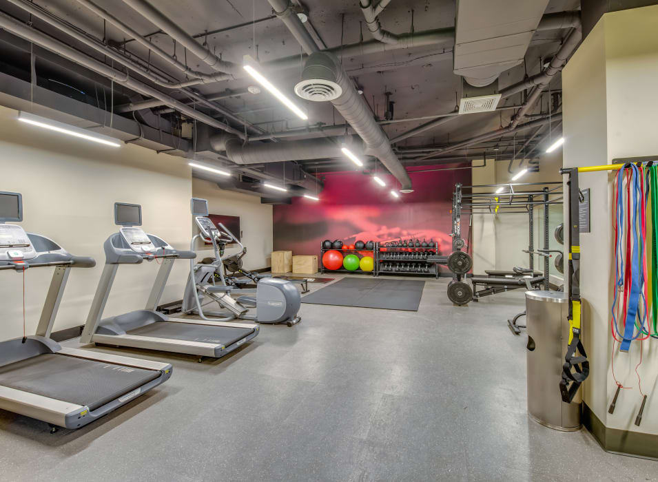 Treadmills and free weights in the fitness center at Verse Seattle in Seattle, Washington
