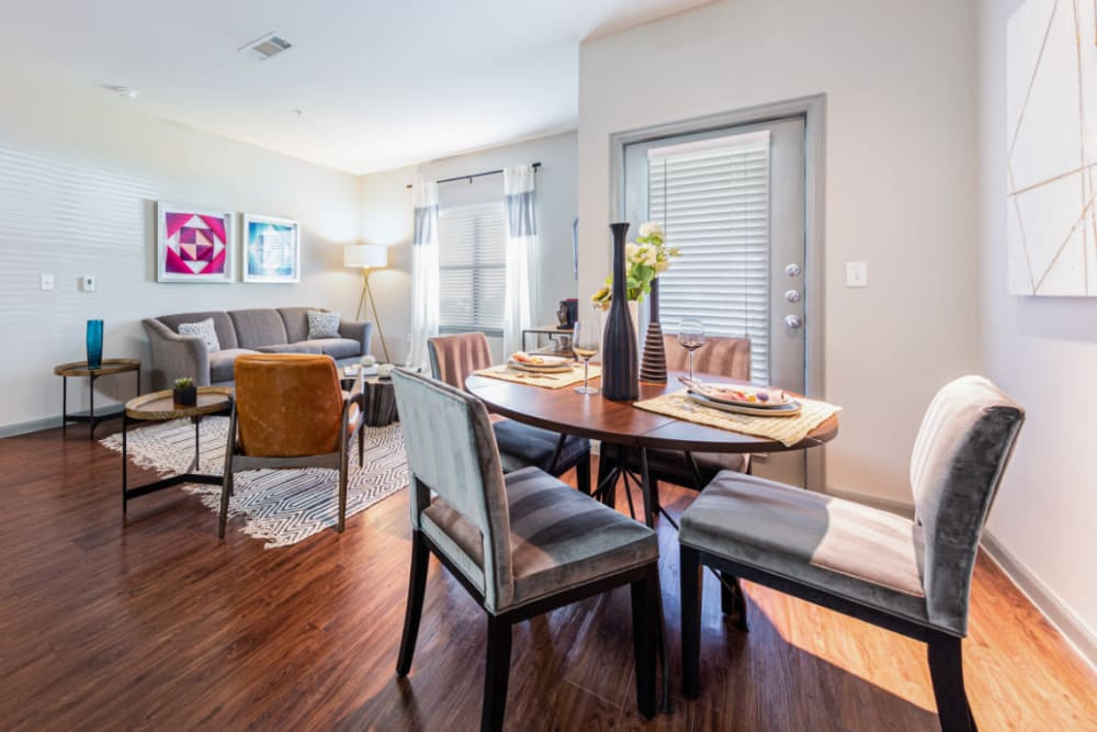 Dining room with wood style flooring at Marquis at Katy in Katy, Texas