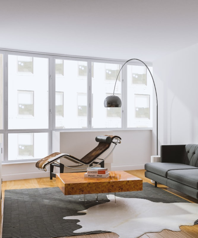 A living room with lots of natural lighting at The Metropolis in New York, New York