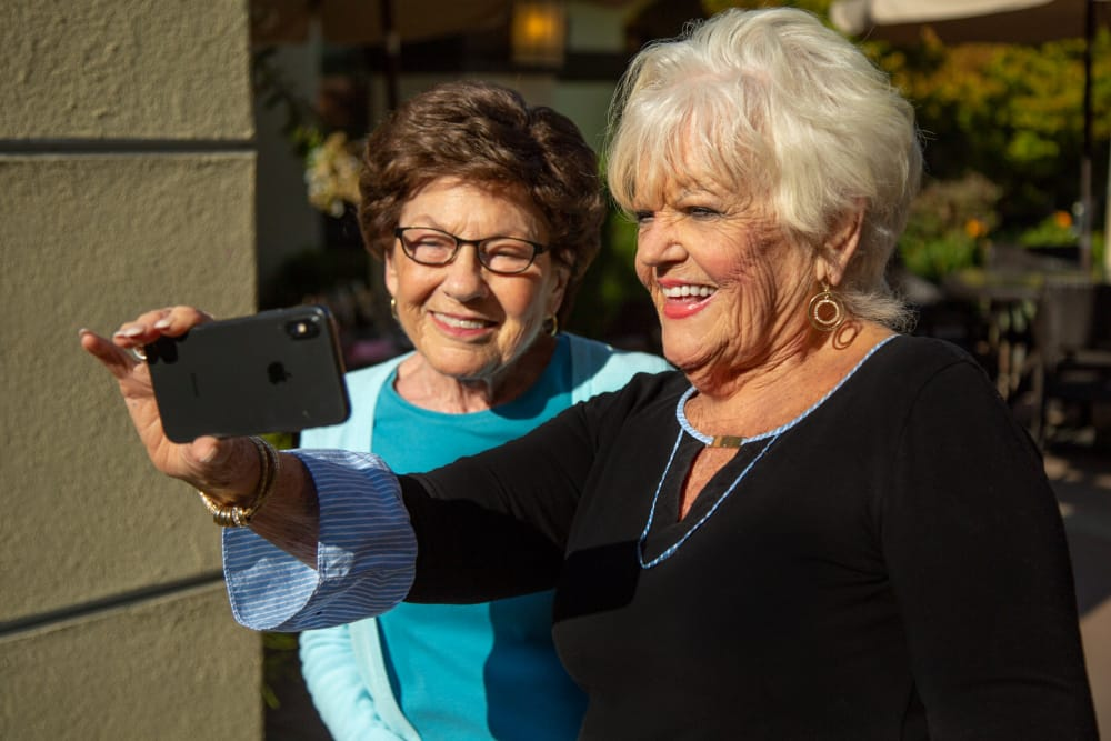 Residents taking a selfie at senior living in Monterey