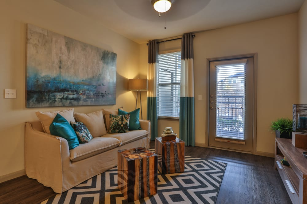 Living room area with windows at Olympus at Waterside Estates in Richmond, Texas