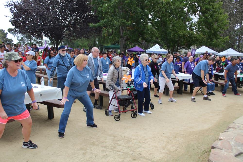 Exercising outside at Merrill Gardens at Santa Maria in Santa Maria, California.