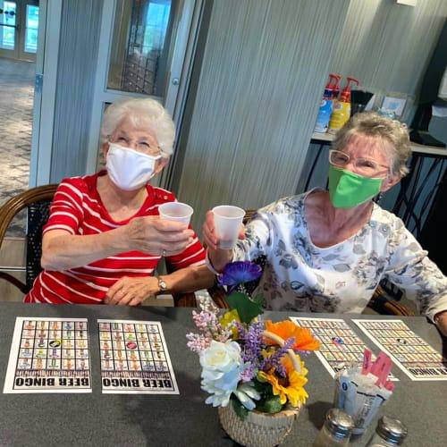 Residents playing bingo while wearing masks at Oxford Villa Active Senior Apartments in Wichita, Kansas