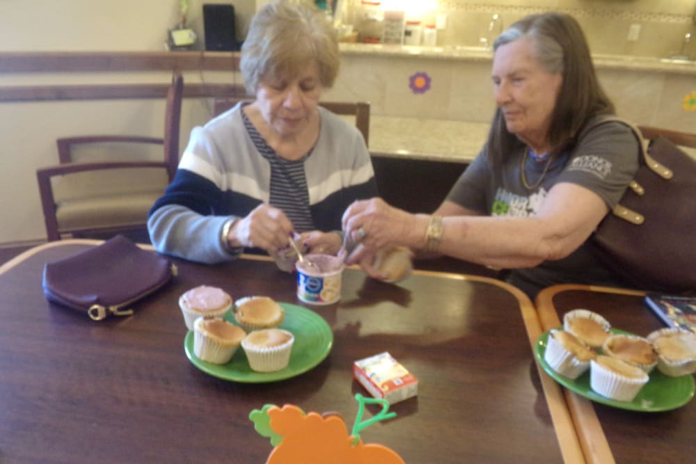 Icing Cupcakes  at Eastern Star Masonic Retirement Campus in Denver, CO